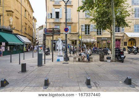 AIX EN PROVENCE,FRANCE-AUGUST 92016:People strolling down the typical street and square of Aix-en-Provence during a summer day.