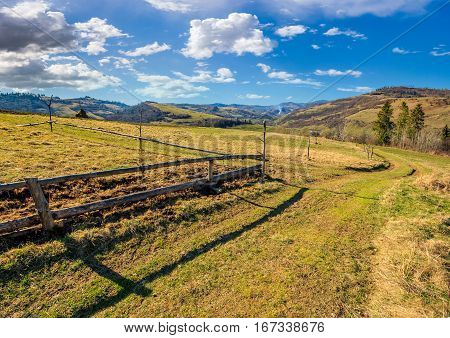 Wooden Fence On The Hillside