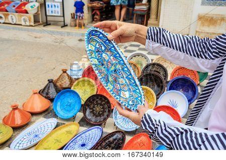 Decorative color dishes at souvenir shop at oriental marketplace