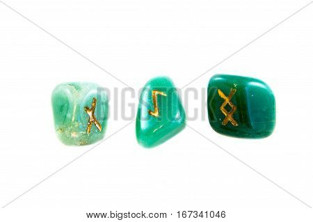 Stone runes isolated on the white background. Esoteric subjects.