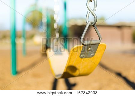 Play park kids' swing. Close up/depth of field, and horizontal view.
