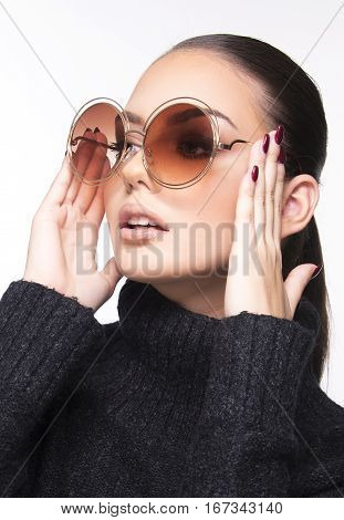 beautiful girl with summer sunglasses and eye wear close up commercial concept