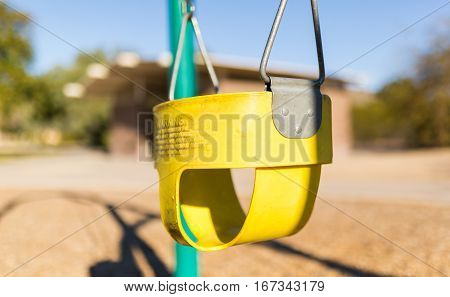 Play park toddler's swing. Close up/depth of field, and horizontal view.