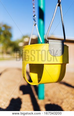 Play park toddler's swing. Close up/depth of field view.