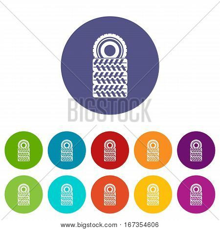 Pile of tires set icons in different colors isolated on white background