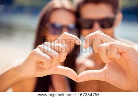 Dream Come True. Happy Family On Honeymoon Gesturing Heart With Fingers, Focus On Hands