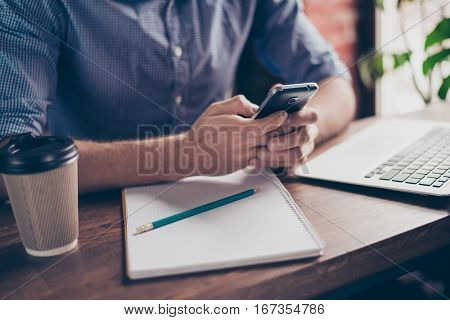 Close Up Of Student Preparing For Lecture And Writing Sms On Smartphone