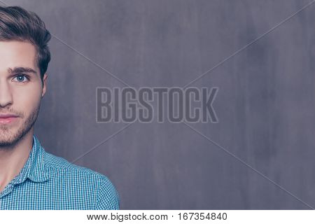 Half-face Portrait Of Happy Handsome Man On Gray Background