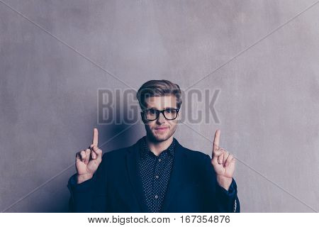 Young Confident Man In Glasses In Formal Wear Pointing Up
