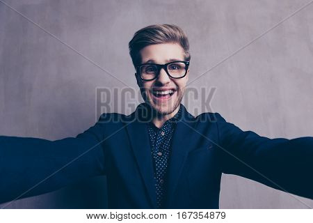 Young Happy Laughing Businessman In Glasses Making Selfie