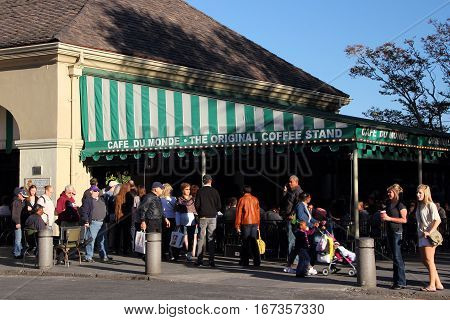 NEW ORLEANS, LA - NOVEMBER 24: Tourists enjoy a bit of New Orleans cuisine at the famous Cafe Du Monde in front of Jackson Square in the historic French Quarter November 24, 2012 in New Orleans, LA.