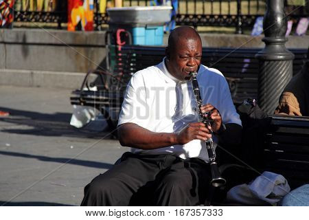 NEW ORLEANS, LA - NOVEMBER 24: A clarinet player entertains the crowd in Jackson Square in the historic French Quarter November 24, 2012 in New Orleans, LA.