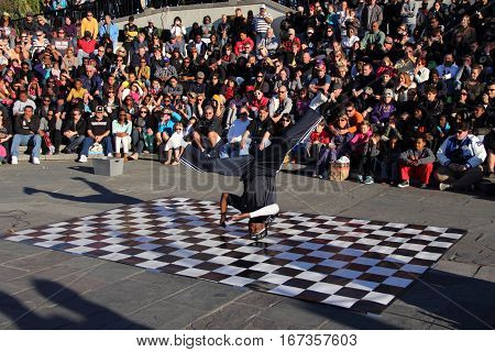 NEW ORLEANS, LA - NOVEMBER 24: Street performer wows a crowd in front of Jackson Square in the historic French Quarter November 24, 2012 in New Orleans, LA.