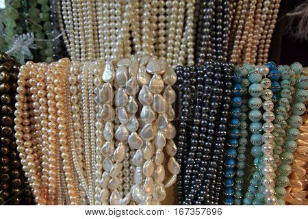 Many pearl necklaces  as a natural background