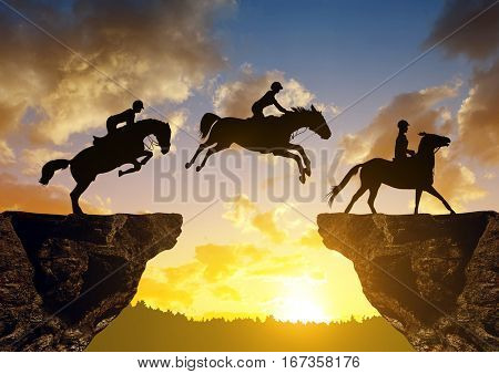 Silhouette of a rider on a horse jumping through the gap between rock at sunset.
