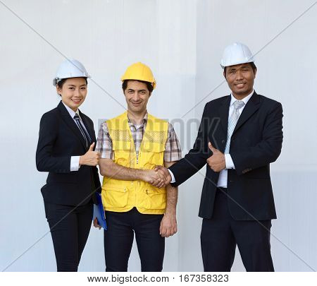 Engineers and supervisors praise labourers the excellent work success on white background.