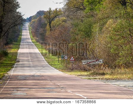 Road with the exit sign of the abandoned city of Chernobyl in the Ukraine the city is located in the Chernobyl Exclusion Zone which was established after the nuclear disaster
