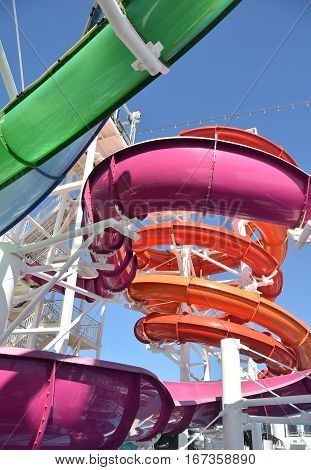 Colorful water slide winding in a spiral