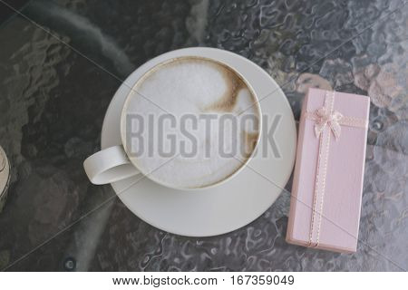 Selective Focus White Cup Of Coffee, Latte On The Wooden Table With Pink Gift.
