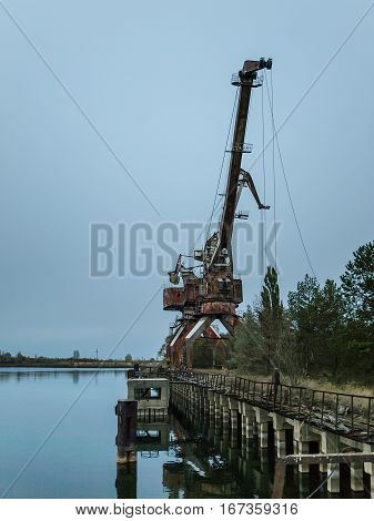 Port crane in the harbor near Pripyat the ghost town in the Chernobyl Exclusion Zone which was established after the nuclear disaster