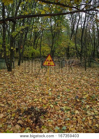 Warning sign in a forest of the ghost town Pripyat in the Chernobyl Exclusion Zone which was established after the nuclear disaster in 1986