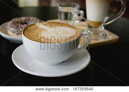 Selective Focus White Cup Of Coffee, Latte On The Wooden Table.