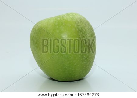 a fresh green Granny Smith apple on a white background