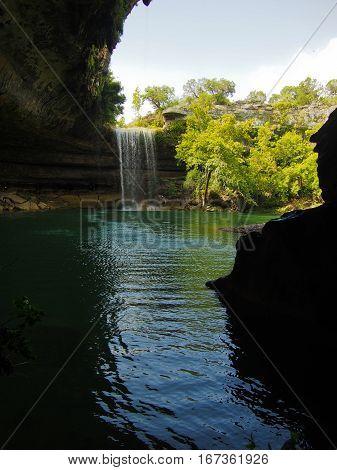 A waterfall at a limestone rock formation at Hamilton Pool Preserve near Austin Texas.