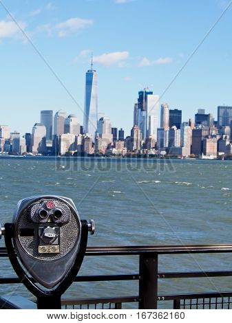 Coin operated binocular overlooking the harbor and skyline of New York City.