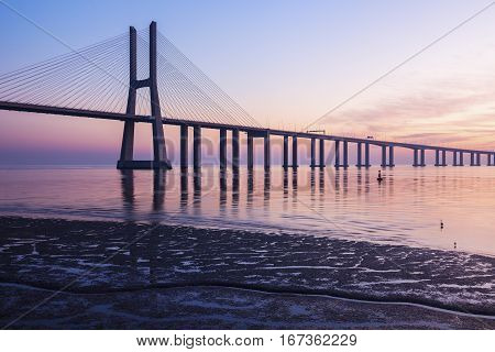 Vasco da Gama Bridge in Lisbon seen at sunrise. Lisbon Portugal.