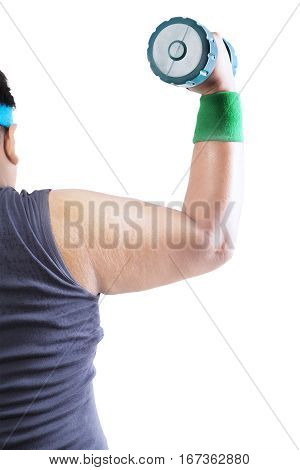 Back view of obese young man is flexing muscles with a dumbbell isolated on white background