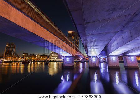 Belfast architecture along River Lagan and illuminated bridge. Belfast Northern Ireland United Kingdom.
