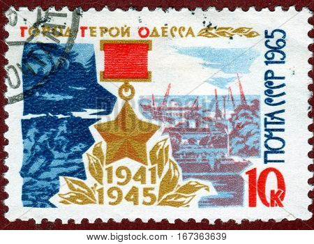 USSR - CIRCA 1965: Postage stamp printed in the USSR shows Star the Hero and view of the city with the inscription