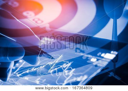 Target Arrow On Dart Board And Stock Market Indicator Graph. Financial Graph And Stock Market Target