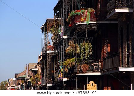 NEW ORLEANS, LA - NOVEMBER 25: Hanging gardens adorn the elaborate balconies of the historic French Quarter November 25, 2012 in New Orleans, LA.