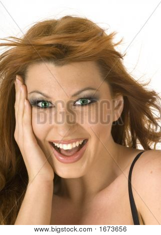 Beautiful Redheaded Woman Looking Happy And Surprised On White Background