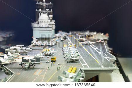 Miniature model of aircraft carrier.