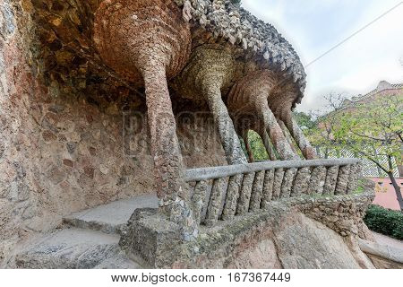 Barcelona, Spain - November 24, 2016: The Laundry Room Portico in Park Guell in Barcelona Spain. It is a public park system composed of gardens and architectonic elements located on Carmel Hill in Barcelona Catalonia (Spain).
