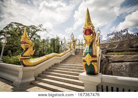 Krabi Thailand - December 26 2016 : Grand staircase lined by naga sculptures in Kaew Korawaram Temple. Krabi Thailand.