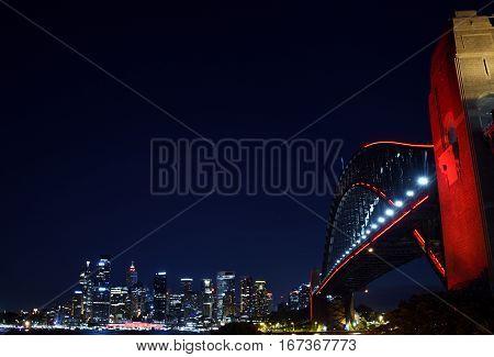 Sydney Australia - Jan 28 2017. Chinese New Year celebrations turned Sydney Harbour Bridge red to usher in the lunar new year. Year of the Rooster in Chinese Horoscope.
