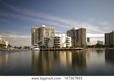 Long exposure image of luxury condos and yachts at Aventura FL USA