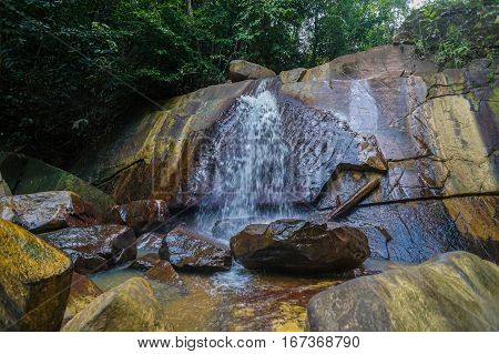 Beautiful waterfall with Borneo jungle forest & amazing rock pattern in Beaufort,Sabah,Borneo.