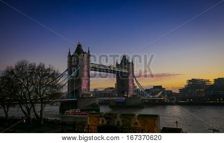 Colorful dramatic sunlgiht at the Tower Bridge and the River Thames London England