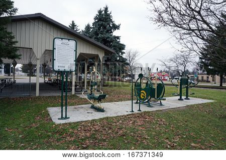 MANCELONA, MICHIGAN / UNITED STATES - NOVEMBER 27, 2016: One may exercise outdoors using fitness equipment in the Railroad Park Fitness Zone, near downtown Mancelona.