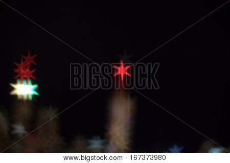 Six Pointed Star Bokeh Lens Effect Dark Black background