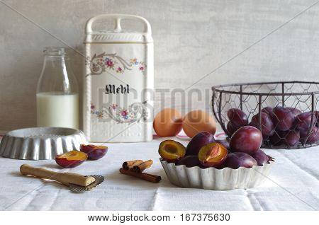 ingredients and bakeware for fresh homemade plum cake - still life