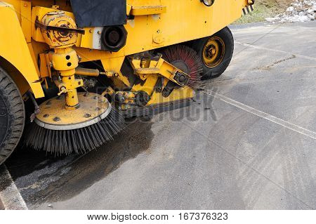 close up on road sweeper in the parking lot
