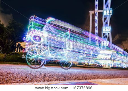 SINGAPORE, OCTOBER 5, 2014: A man riding a super cool bike with light through Marina Bay on October 5, 2014 in Singapore.