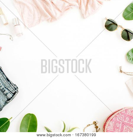 Frame of trendy feminine clothes and accessories. Flat lay top view