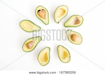 Sliced raw avocado arrangement. Flat lay top view. Creative food concept